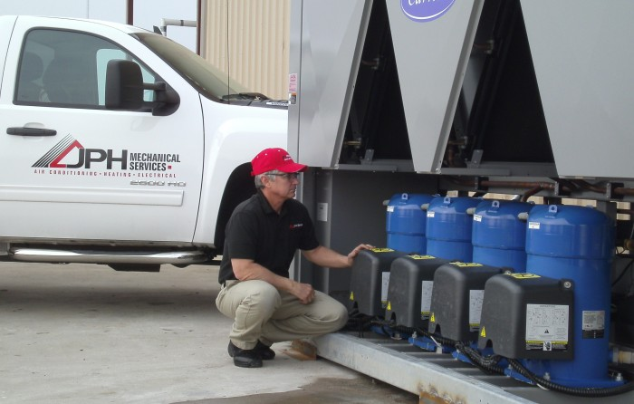 Image showing Hvac professional testing Carrier chiller